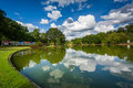 Beautiful Clouds Reflecting In The Lake At Freedom Park, In Char Stock Image - 82815441
