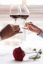 Hands Of The African American Couple Holding Wineglasses Stock Images - 82819154