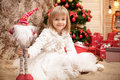 Smiling Girl With Christmas Toy Stock Images - 82823254