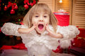 Little Girl Surprised  On A Christmas Background Royalty Free Stock Photos - 82823628