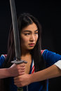 Asian Lady With Sword In Studio Stock Photography - 82850692