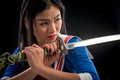 Asian Lady With Sword In Studio Stock Photography - 82851292