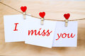 Miss You Text On Stickers Hanging On Heart Shape Pins Royalty Free Stock Images - 82858169