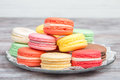 Colorful Macaroons Pastel Colors With Different Flavors On Glass Plate Royalty Free Stock Images - 82859319