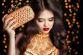 Elegant Fashion Brunette Woman In Gold. Wavy Hair Style. Red Lip Stock Image - 82870421