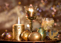 Easter Eggs Golden  And A Burning Candle Royalty Free Stock Images - 8297349