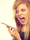 Angry Young Woman Talking On Phone Stock Image - 82904561