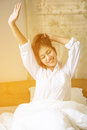 Tired Sleepy Woman Waking Up With A Stretch Royalty Free Stock Images - 82905869