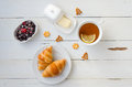 Breakfast From Hot Croissants, Butter,tea And Currants On Wooden Table. Flat Lay Stock Photos - 82932183