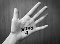 Text Xoxo And Silhouette Of Heart On A Human Hand. Black And White Photo. Royalty Free Stock Image - 82933496