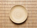 Empty Plate On A Bamboo Mat Royalty Free Stock Photos - 83005278