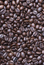 From Above Shot Of Coffee Beans On Table. Vertical Close Up Shot. Royalty Free Stock Images - 83048069