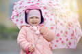 Joyful Child With Pink Flower Umbrella In The Sun Light After Rain Royalty Free Stock Photo - 83055595