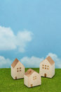 Houses On Green Grass Over Blue Sky And Clouds. Royalty Free Stock Photo - 83125505