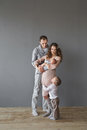 Young Adult Family With An Infant And A Child In A Studio Royalty Free Stock Photos - 83128668