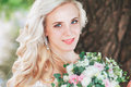Beautiful Bride. Wedding Hairstyle And Make Up.Young Bride In Wedding Dress Holding Bouquet Royalty Free Stock Images - 83154659