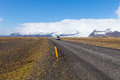 Car Driving On The Icelandic Ring Road Passes The Vatna Glacier Royalty Free Stock Photo - 83164065