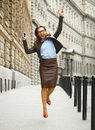 Delighted Business Woman Jumping For Joy While Talking On The Sm Royalty Free Stock Photo - 83179545