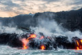 Molten Lava Flowing Into The Pacific Ocean Royalty Free Stock Photos - 83199808