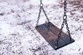 Empty Swing On Children Playground Under Snow Stock Images - 83214624