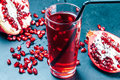 Pomegranate Juice On Blue Table Stock Photo - 83233520