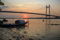 Wooden Boat On River Hooghly At Sunset With The Vidyasagar Bridge At The Backdrop Stock Images - 83252424
