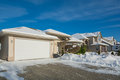 Wide Garage Of Luxury House With Driveway And Front Yard In Snow Stock Photos - 83252723