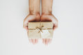 Hand Holding Brown Gift Box With Happy Valentines Note, On White Background Royalty Free Stock Image - 83267286