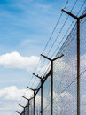 Barbed Wire Fence Under The Sky Background Royalty Free Stock Image - 83270806