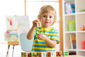 Little Preschooler Kid Boy Playing With Toy Cubes And Memorizing Letters. Early Education And Preschool Concept Stock Photos - 83348953