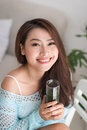 Smiling Young Asian Woman Drinking Green Fresh Vegetable Juice O Stock Photos - 83382813
