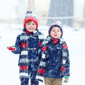 Happy Children Having Fun With Snow In Winter Royalty Free Stock Photography - 83429587
