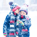 Happy Children Having Fun With Snow In Winter Royalty Free Stock Image - 83429766