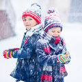 Happy Children Having Fun With Snow In Winter Royalty Free Stock Image - 83429826