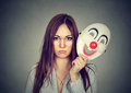 Upset Worried Woman With Sad Expression Taking Off Clown Mask Royalty Free Stock Photography - 83456197