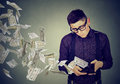 Sad Man Looking At Wallet With Money Dollar Banknotes Flying Away Stock Photography - 83456452