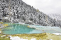 Blue Green Pond On Snowy Mountain Royalty Free Stock Images - 83467689
