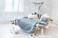 White Loft Interior In Classic Scandinavian Style. Hanging Bed Suspended From The Ceiling. Cozy Large Folded Gray Plaid Royalty Free Stock Photography - 83467707
