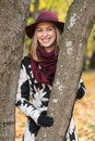 Woman In A Floral Patterned Coat And Wine Red Hat In The Park, By The River. Happy Girl, Colorful Autumn Forest. Portrait Of Lady Stock Photography - 83475612
