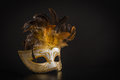 Pretty Venician Golden Carnival Mask With Feathers On A Black Background Royalty Free Stock Photo - 83499005