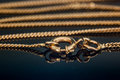 Gold Necklace Chain Clasp Or Closure Closed On Reflecting Glass Table Stock Photo - 83511980