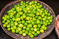 Limes In The Wicker Basket On The Vietnamese Market Royalty Free Stock Photo - 83515425