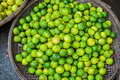 Limes In The Wicker Basket On The Vietnamese Market Stock Images - 83515794