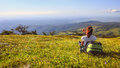 Female Traveller With Backpack Making Photo Of Mountain Lanscape Stock Images - 83521184