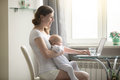 Woman And A Baby At The Laptop Stock Photos - 83524393