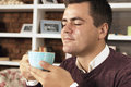 Young Man Drink Coffee, Tea Or Chocolate Stock Image - 83539201