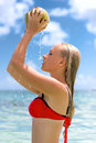 Woman In The Sea With Coconut That Dripping Stock Photo - 83539620