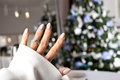 Diamond Ring On A Finger Under The Christmas Tree. Stock Image - 83540801