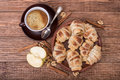 Fresh Homemade Croissants With Apple And Cup Of Coffee. Royalty Free Stock Image - 83587736