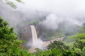 Beautiful Hidden Ekom Waterfall Deep In The Tropical Rain Forest Of Cameroon, Africa Stock Photography - 83609062